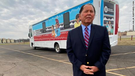 Dr. Ron Shaw of Osage Nation Health Services stands in front of the bus they're using to reach people happy to get a Covid-19 vaccine.