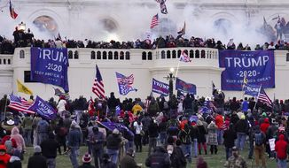 In this Jan. 6, 2021 file photo rioters supporting President Donald Trump storm the Capitol in Washington. (AP Photo/John Minchillo, File)