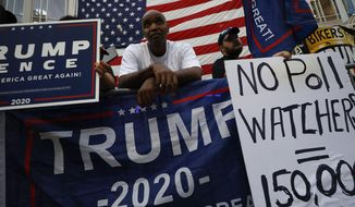 Supporters of President Donald Trump protest outside the Pennsylvania Convention Center in Philadelphia, Sunday, Nov. 8, 2020, a day after the 2020 election was called for Democrat Joe Biden.(AP Photo/Rebecca Blackwell)
