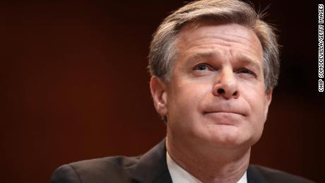 FBI Director Wray knocks down conspiracy theory that January 6 rioters were 'fake Trump protesters'