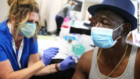 Larry Green receives a Band-Aid from registered nurse Teresa Frey after he received his second dose of the Moderna Covid-19 vaccine at Lincoln Memorial Congregational Church UCC last month in Los Angeles.