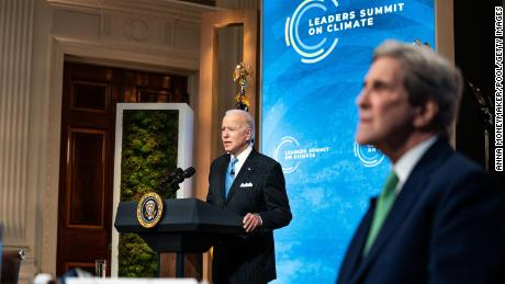 President Joe Biden, left, delivering remarks alongside Special Presidential Envoy for Climate John Kerry on the second day of the virtual climate summit on April 23.