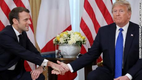 Former US President Donald Trump, right,  and French President Emmanuel Macron in London on December 3, 2019, for a meeting of leaders from the transatlantic security and political alliance NATO.