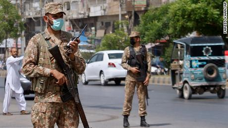 Army troops help enforce new Covid-19 restrictions in Karachi, Pakistan, on April 27.