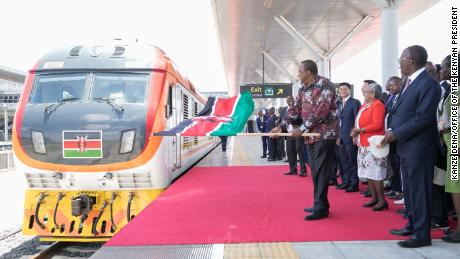 Kenyan President Uhuru Kenyatta unveils a railway project in 2019. Kenyatta has assured citizens they will receive their second vaccine doses, but some Kenyans are concerned about supply.
