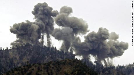 Explosions rock al Qaeda positions in the Tora Bora region of Afghanistan after an attack by US warplanes on December 14, 2001.